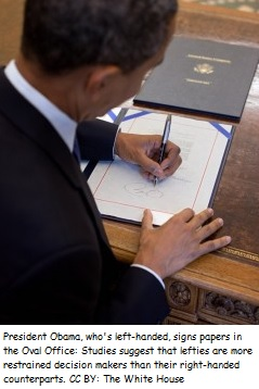 Check out the President's position.  His paper is set up for a right-handed writer.